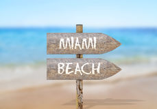 Wooden direction sign with Miami beach Stock Photography