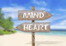 Wooden direction sign with mind and heart. Close stock images