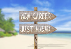 Wooden direction sign with new career just ahead Stock Photos