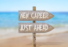 Wooden direction sign with new career just ahead Stock Photo