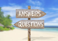 Wooden direction sign with questions and answers. Close Stock Images