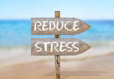 Wooden direction sign with reduce stress Stock Image