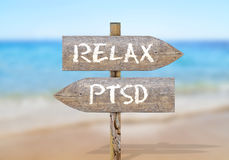 Wooden direction sign with relax and ptsd Stock Photo