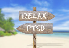 Wooden direction sign with relax and ptsd. Close Stock Photo