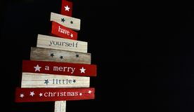 Wooden directional boards with Christmas saying written on them stock image