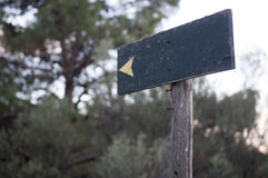 Wooden directional sign. Directional wooden sign in forest Royalty Free Stock Image