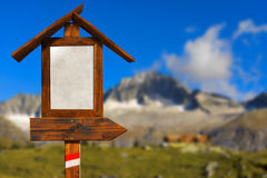 Wooden Directional Sign in Mountain Stock Images