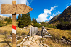 Wooden Directional Trail Sign in Mountain Royalty Free Stock Photography
