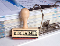 Wooden disclaimer stamp and binder Stock Photos
