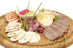 Wooden dish with bacon and sausage Stock Image