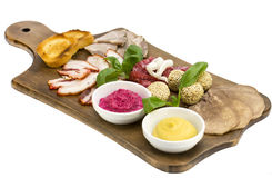 Wooden dish with bacon and sausage Royalty Free Stock Images