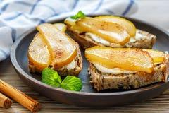 Crostini homemade bread, ricotta and pear. Stock Image