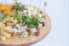 Wooden dish with different types of cheese royalty free stock photo