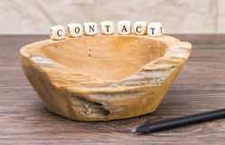 Wooden dish. Image shows an old wooden dish with wooden cubes on a table royalty free stock images