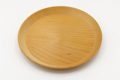 Wooden dish on isolated background Stock Photos