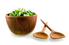 Wooden dish with leek. On white background royalty free stock image