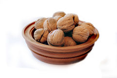 Wooden dish with nuts Royalty Free Stock Photography
