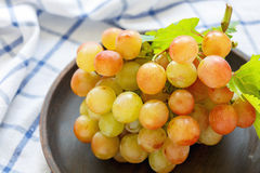 Bunch of grapes on a dish closeup. Royalty Free Stock Photos