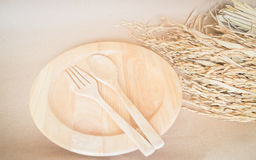 Wooden dish set and paddy rice Royalty Free Stock Image