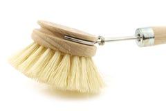 Wooden dish washing brush Stock Images