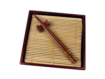 Wooden dishes. Chopsticks in a specific Japanese wooden dish.Usually used for eating soba in different traditional restaurants Stock Photos