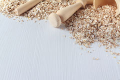 Wooden dishes and organic oats on the light tones table royalty free stock photography