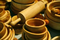 Wooden dishes with rolling pin. Wooden dishes - rolling pin is in focus area Stock Images