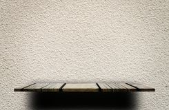 Wooden display shelf on gray cement wall. Wooden display shelf on Rough gray cement wall Stock Photos