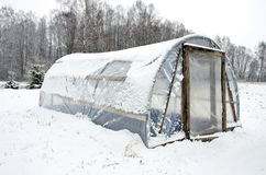 Wooden diy homemade greenhouse polythene snow Royalty Free Stock Photography