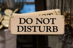 Wooden Do Not Disturb Sign Black Text Printed Decoration Hanging Stock Image