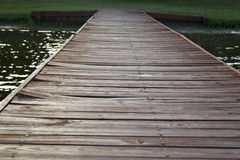 Wooden Dock. An old wooden dock heading off in the distance Royalty Free Stock Image