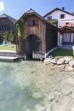 Wooden dock at alpine lake Mondsee Stock Photos
