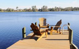 Wooden Dock with Armchairs Stock Photos