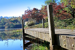 Wooden Dock in the Autumn. Wooden dock in Autumn with mountains in distance Royalty Free Stock Photos