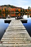 Wooden dock on autumn lake Stock Image