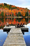 Wooden dock on autumn lake Stock Photo