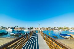 Wooden dock in Balboa island harbor in Orange County. Southern California, USA royalty free stock photos