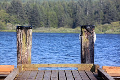 Wooden Dock on a Blue Lake Stock Photography