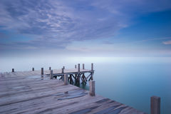Wooden dock in blue morning Stock Photos