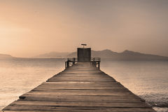 Wooden Dock on Calm Lake Stock Photography