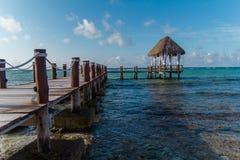 A wooden dock on the Caribbean Sea in Mexico, Yucatan. Waves Stock Photos