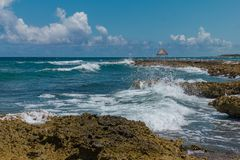 A wooden dock on the Caribbean Sea in Mexico, Yucatan. Waves Stock Photography