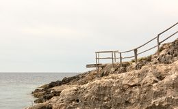 Wooden dock at the cliff Royalty Free Stock Image