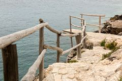 Wooden dock at the cliff Stock Images