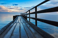 Wooden dock with clouds. Wooden dock after rain at Baikal lake Stock Photos