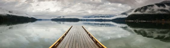 Wooden Dock on Harrison Lake, British Columbia, Canada Royalty Free Stock Images