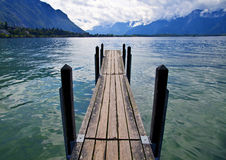 Wooden Dock in Lake Leman. Switzerland royalty free stock images