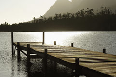 Wooden Dock In Lake At Sunset Royalty Free Stock Photo