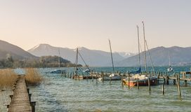 Wooden dock in lake tegernsee Royalty Free Stock Images