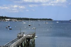 Wooden Dock in a Maine Harbor Stock Photo